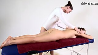 Pussy of Nikita rubbed in a lesbian massage