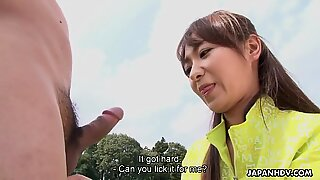 Asian chick gets sexual on an outdoor fotball field