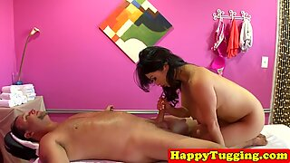 Oriental masseuse with bigtits gives handjob